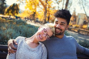 Outdoor portrait of romantic and happy mixed race young couple